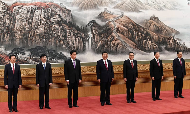 The Communist Party of China's new Politburo Standing Committee, the nation's top decision-making body (L-R) Han Zheng, Wang Huning, Li Zhanshu, Chinese President Xi Jinping, Premier Li Keqiang, Wang Yang, Zhao Leji meet the press at the Great Hall of the People in Beijing on Wednesday.— AFP