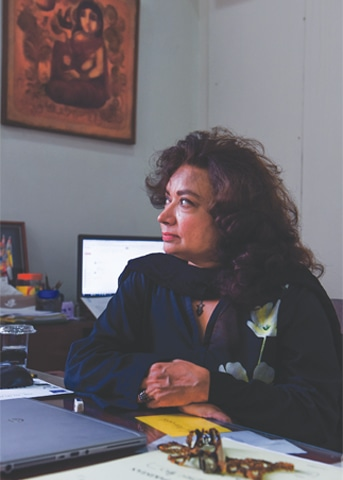 The museologist at her office desk