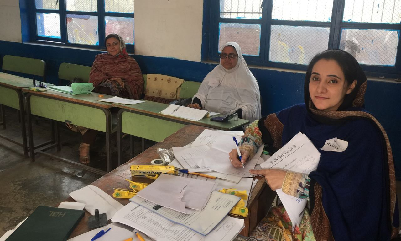 Polling staff perform duties at a women's polling station. Women have come out in large numbers to vote in NA-4. —Photo by Sirajuddin