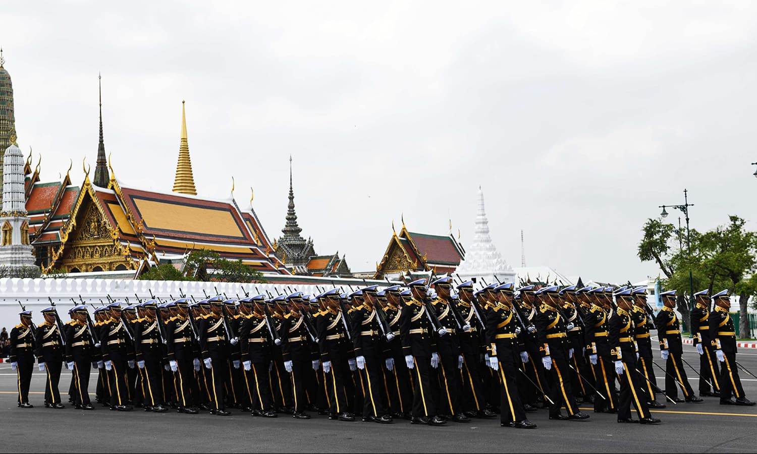 Thai royal military personnel take part in the funeral procession. — AFP