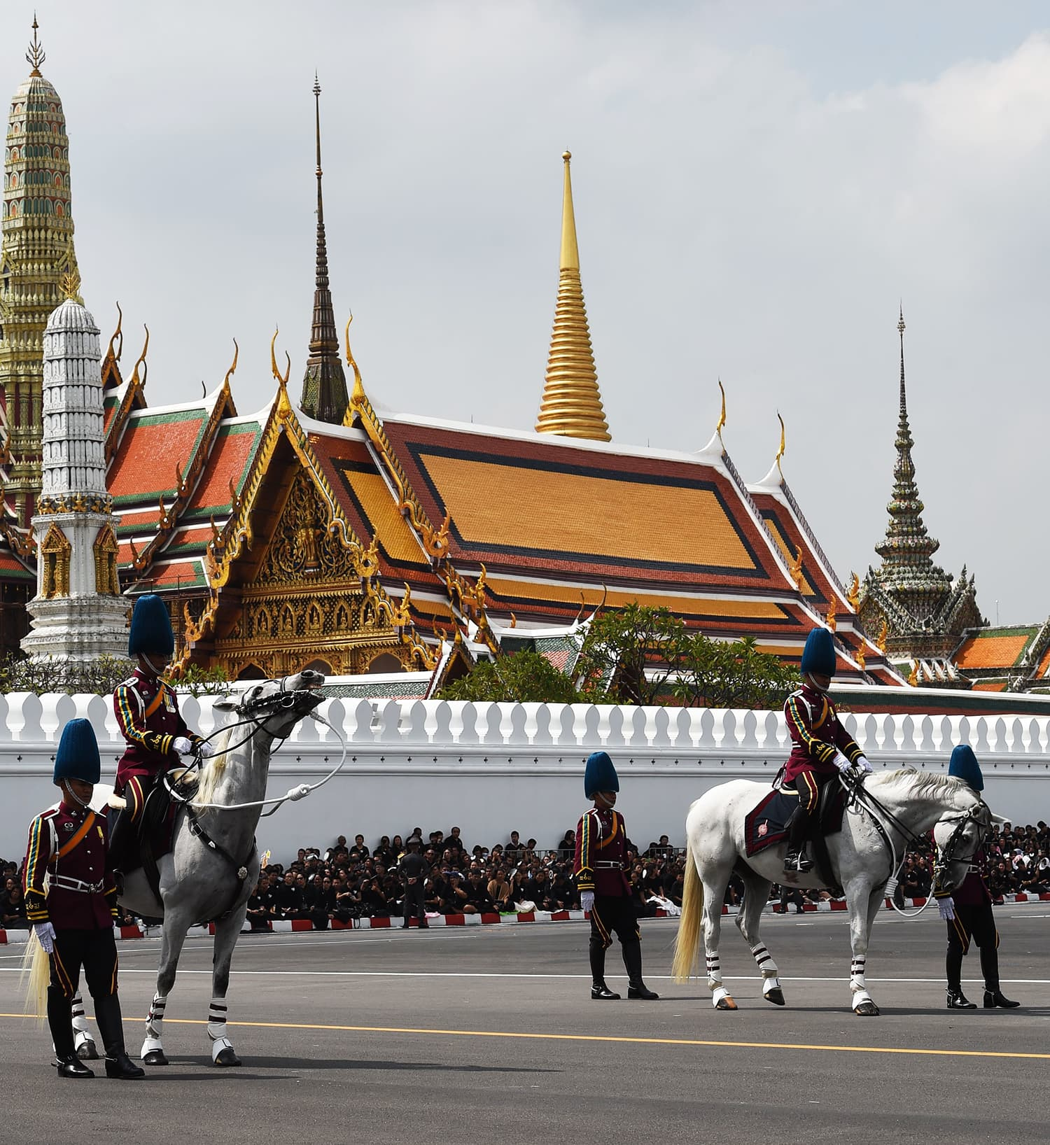 Royal guards take part in the funeral procession of late Thai King Bhumibol Adulyadej. —AFP