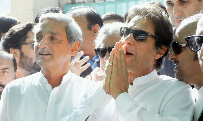 PTI chief Imran Khan joins his hands in a penitent gesture, mimicking his apology to the ECP, for the benefit of TV cameras after Thursday's hearing.—Online