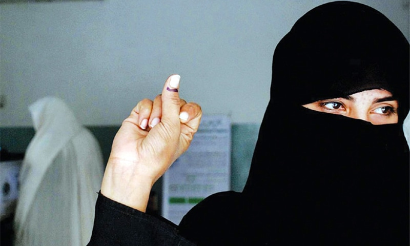 PESHAWAR: A woman showing her marked thumb after casting her vote in the by-election.—APP
