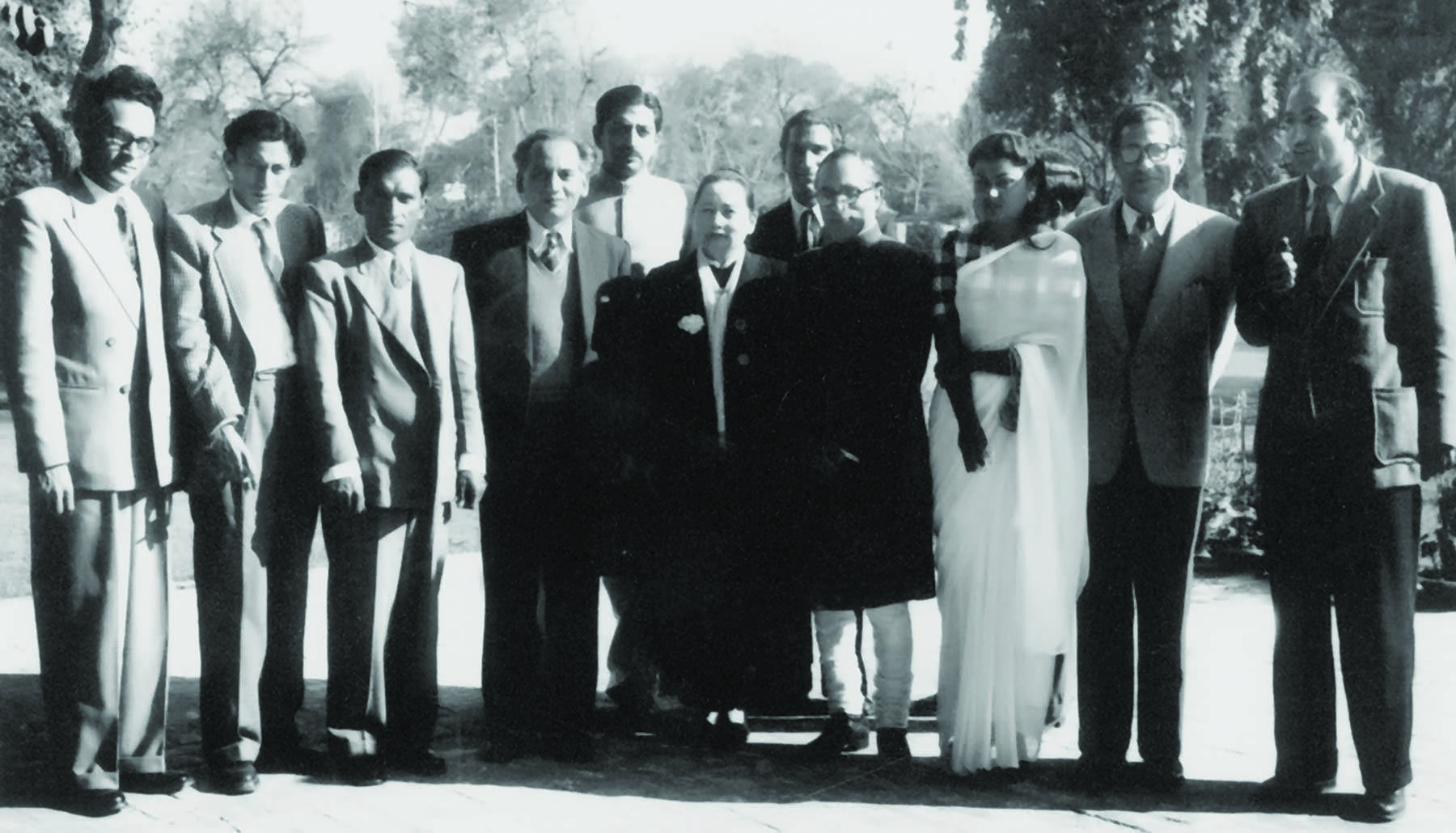 AHMAD Ali Khan (extreme left) at a reception hosted by Mian Iftikharuddin, the publisher of Pakistan Times, Imroz and Lail-O-Nahar, in honour of the visiting Chinese political dignitary, Madame Soong Ching Lee (centre), at his house in Lahore in the early 1950s. Standing next to Mian Sahib (from left) are Hajra Masroor, Khan Sahib's wife, Ahmed Nadeem Qasmi and Hameed Akhtar. Faiz Ahmad Faiz and Mazhar Ali Khan are standing next to the Chinese guest of honour, while Zaheer Babar is seen next to Khan Sahib. | Photo: Ahmad Ali Khan Family Archives