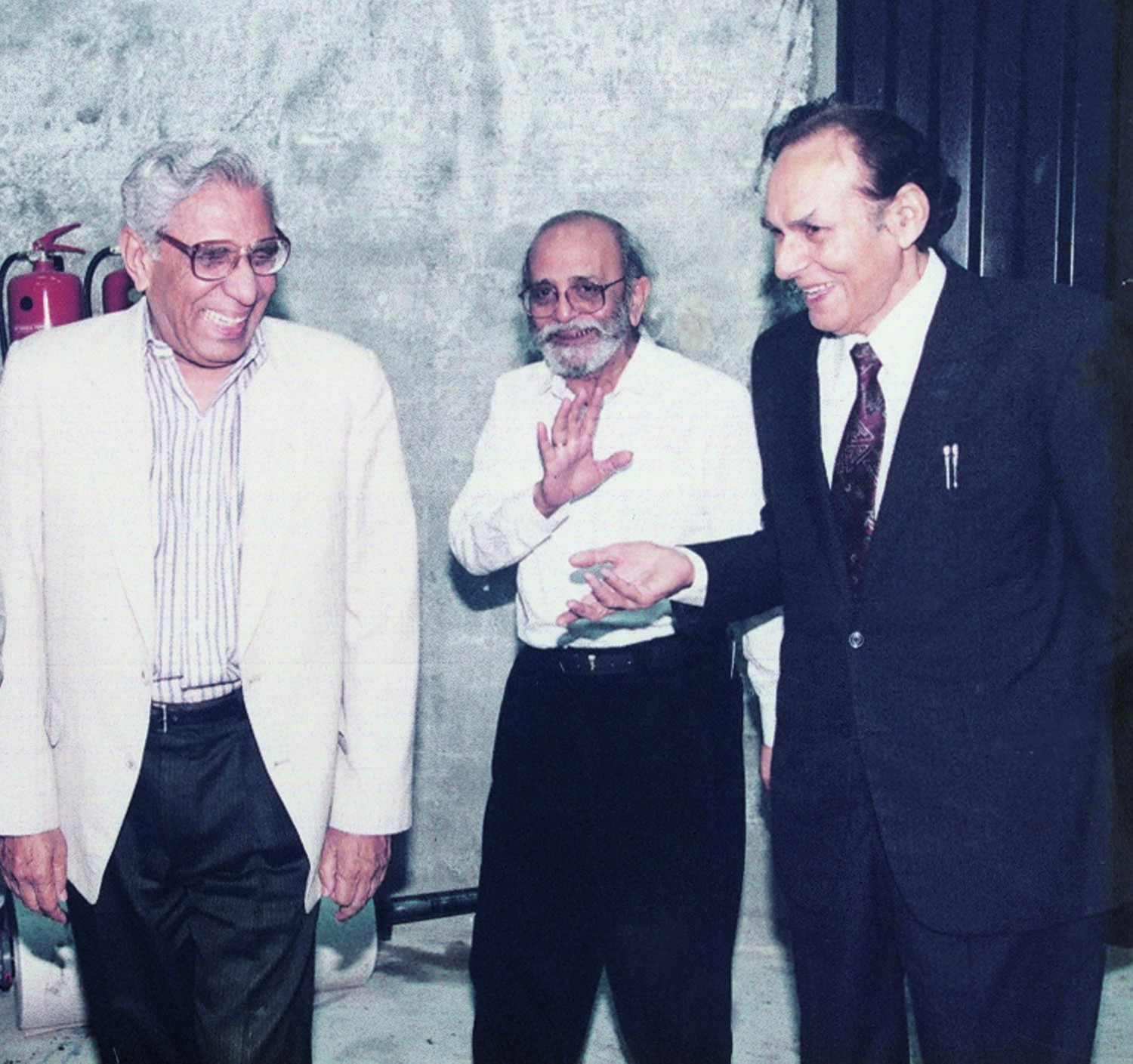 AT the launching ceremony of Dawn's Islamabad Edition in April 2001, Ahmad Ali Khan is seen sharing a light moment with his long-time colleagues Saleem Asmi (centre), who was Dawn's Editor at the time, and Muhammad Ziauddin (left), the Resident Editor at Islamabad. | Photo: Ahmad Ali Khan Family Archives