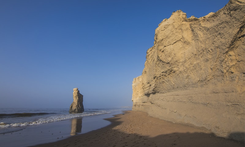 Bujih Koh, a lone rock formation rising from the sand