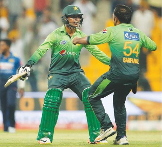 SHADAB Khan and Sarfraz Ahmed celebrate the victory.—AP