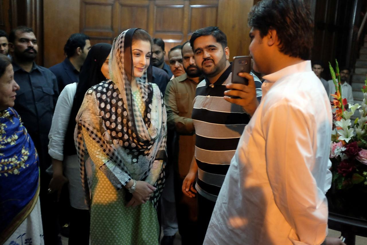 A PML-N supporter takes a selfie with Maryam Nawaz, the daughter of ousted