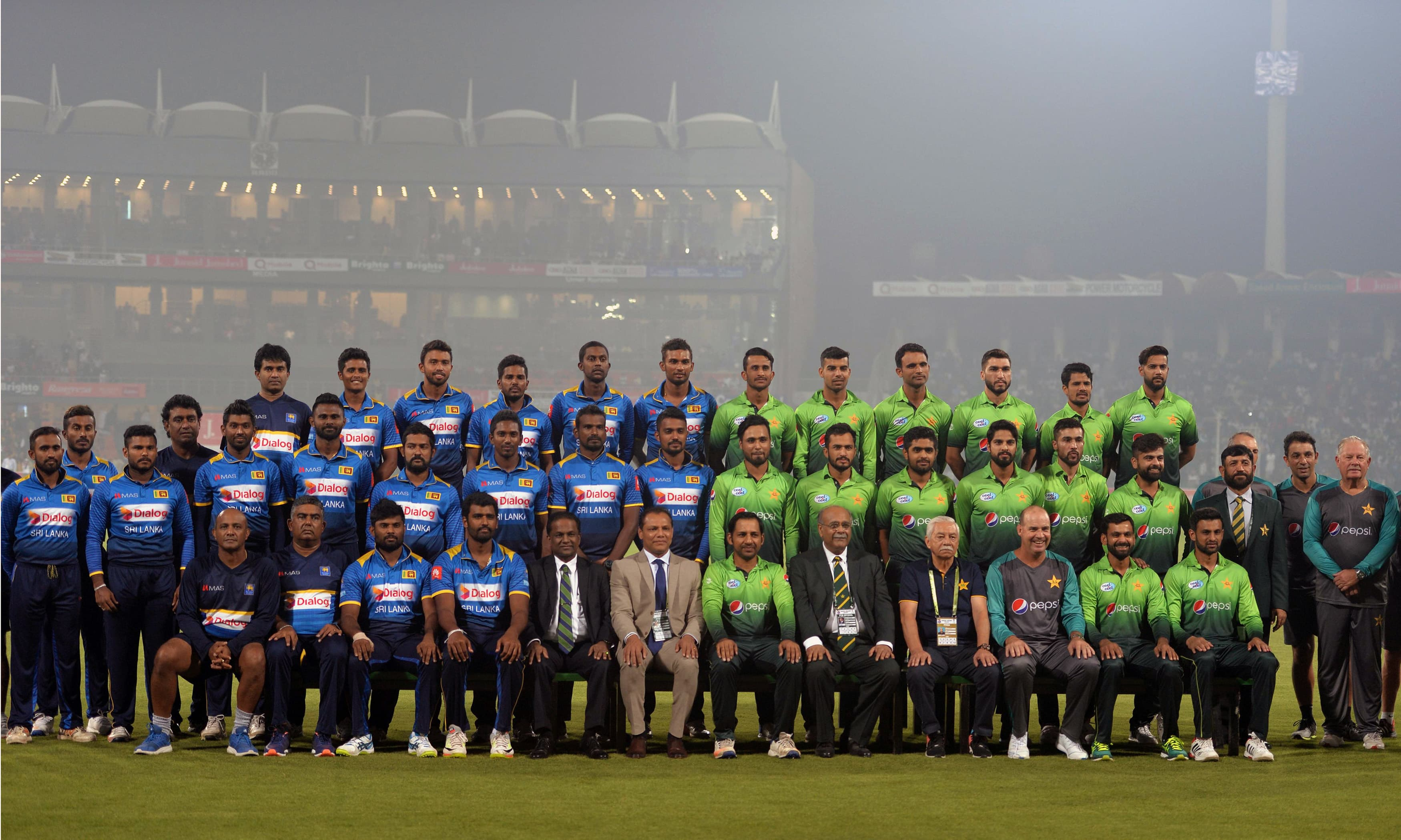 Pakistani and Sri Lankan cricketers and officials pose for a photograph.—AFP