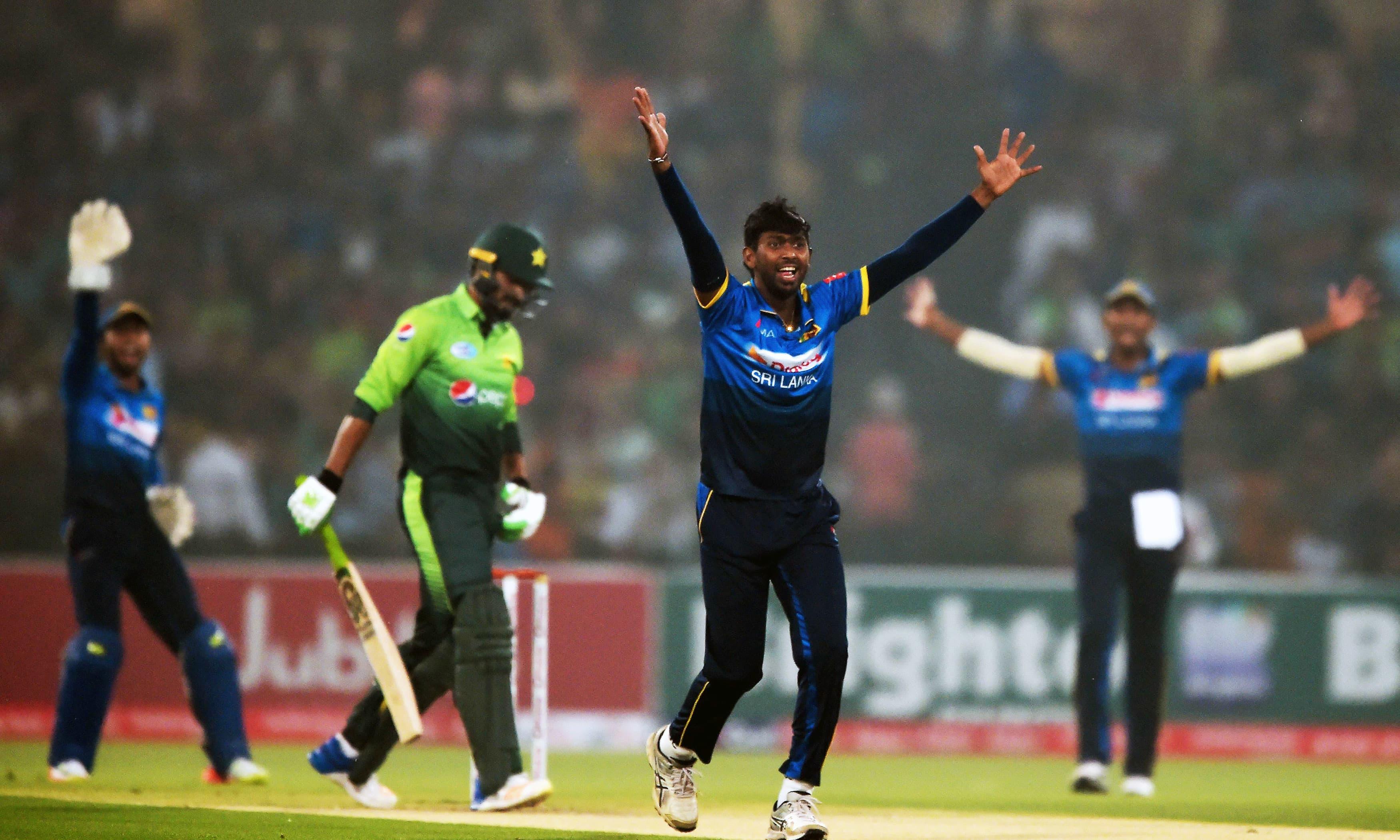 Vikum Sanjaya makes an unsuccessful leg before wicket appeal against Umar Amin. —AFP