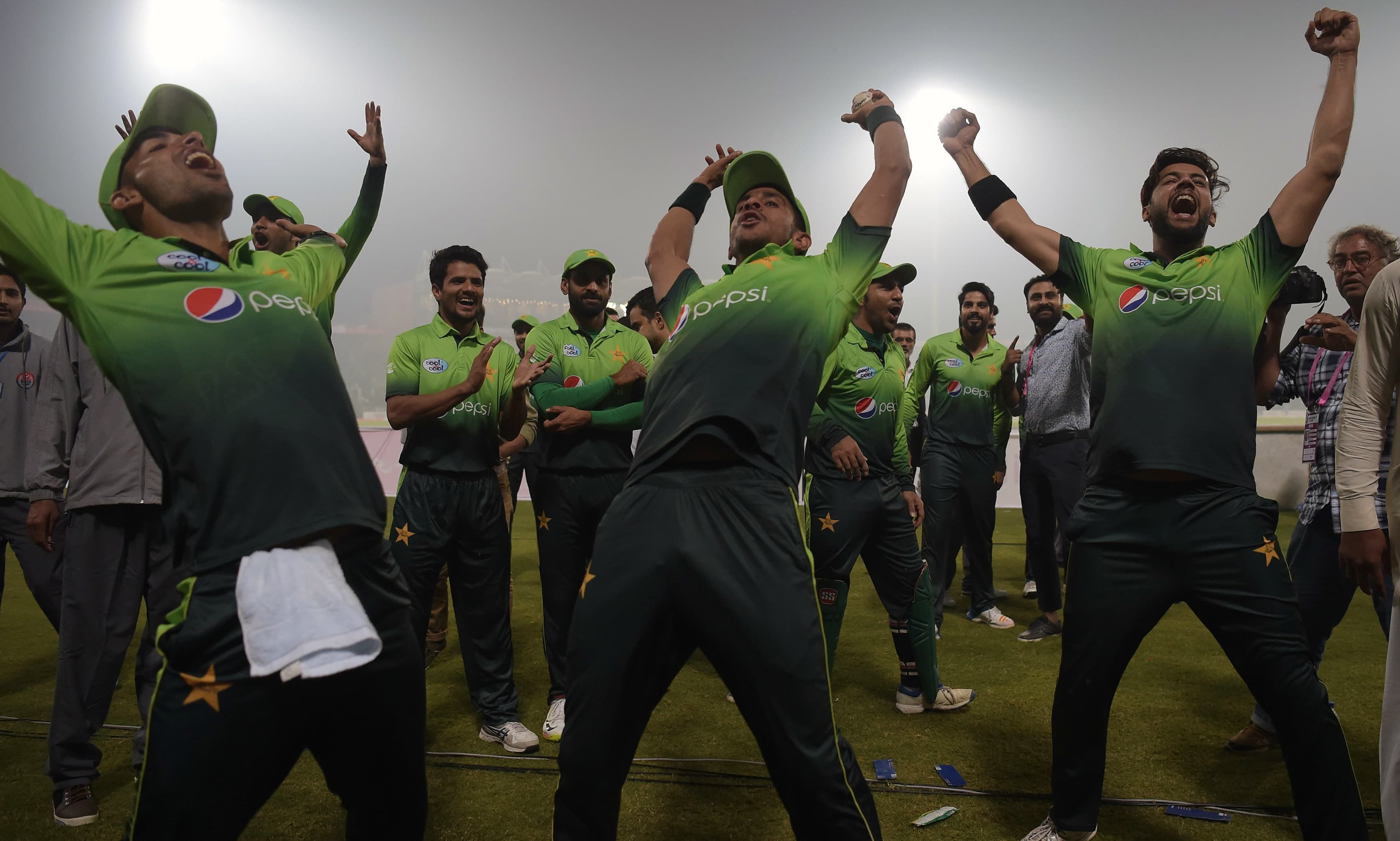 Pakistani players celebrate after winning the third T20 cricket match against Sri Lanka. —AFP