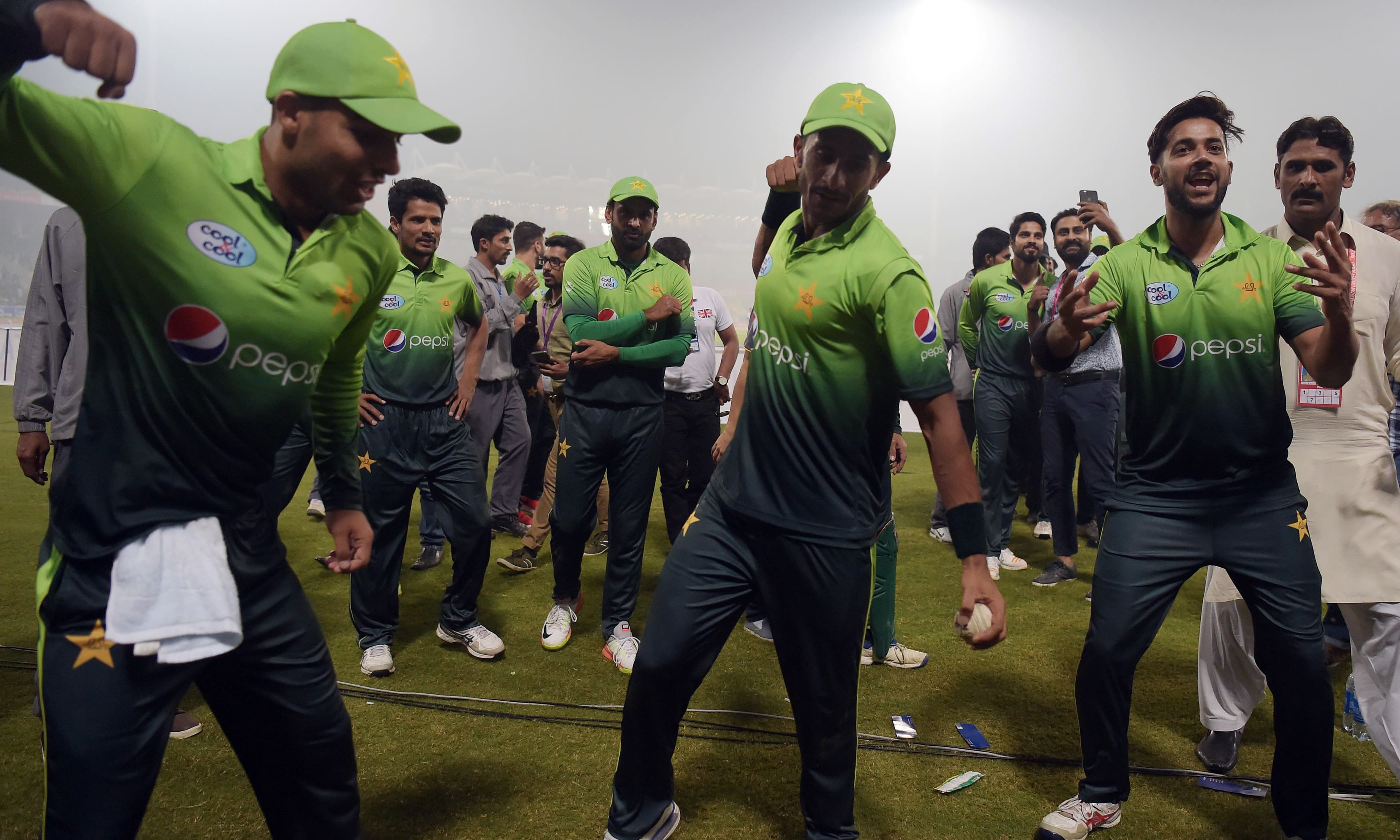 Players celebrate after winning the third and final T20 cricket match against Sri Lanka at Gaddafi Cricket Stadium in Lahore.—AFP