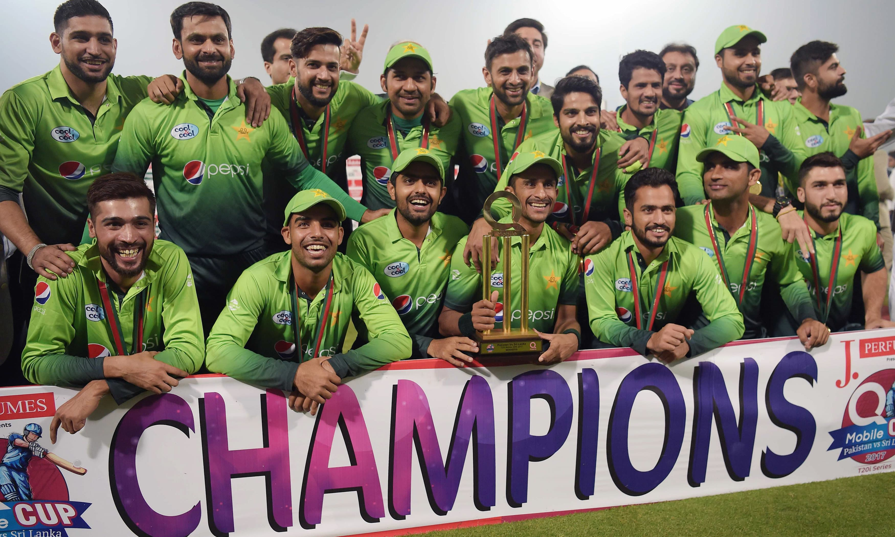Pakistan's cricket team pose for photographs with the trophy after winning the third and final T20 cricket match against Sri Lanka. —AFP