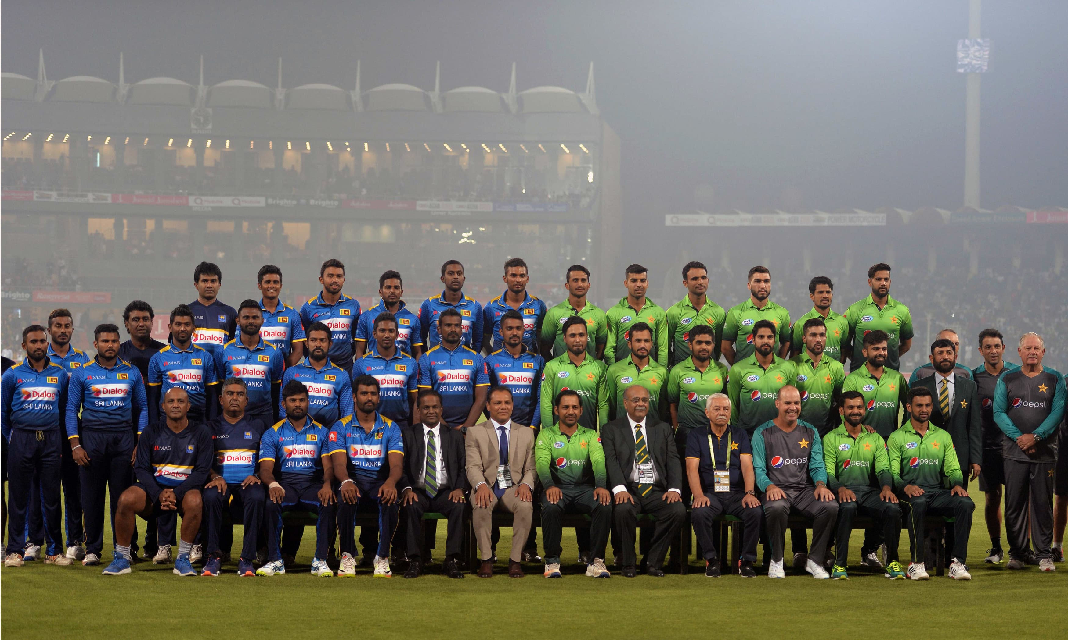 Pakistani and Sri Lankan cricketers and officials pose for a photograph before the start of the match. —AFP