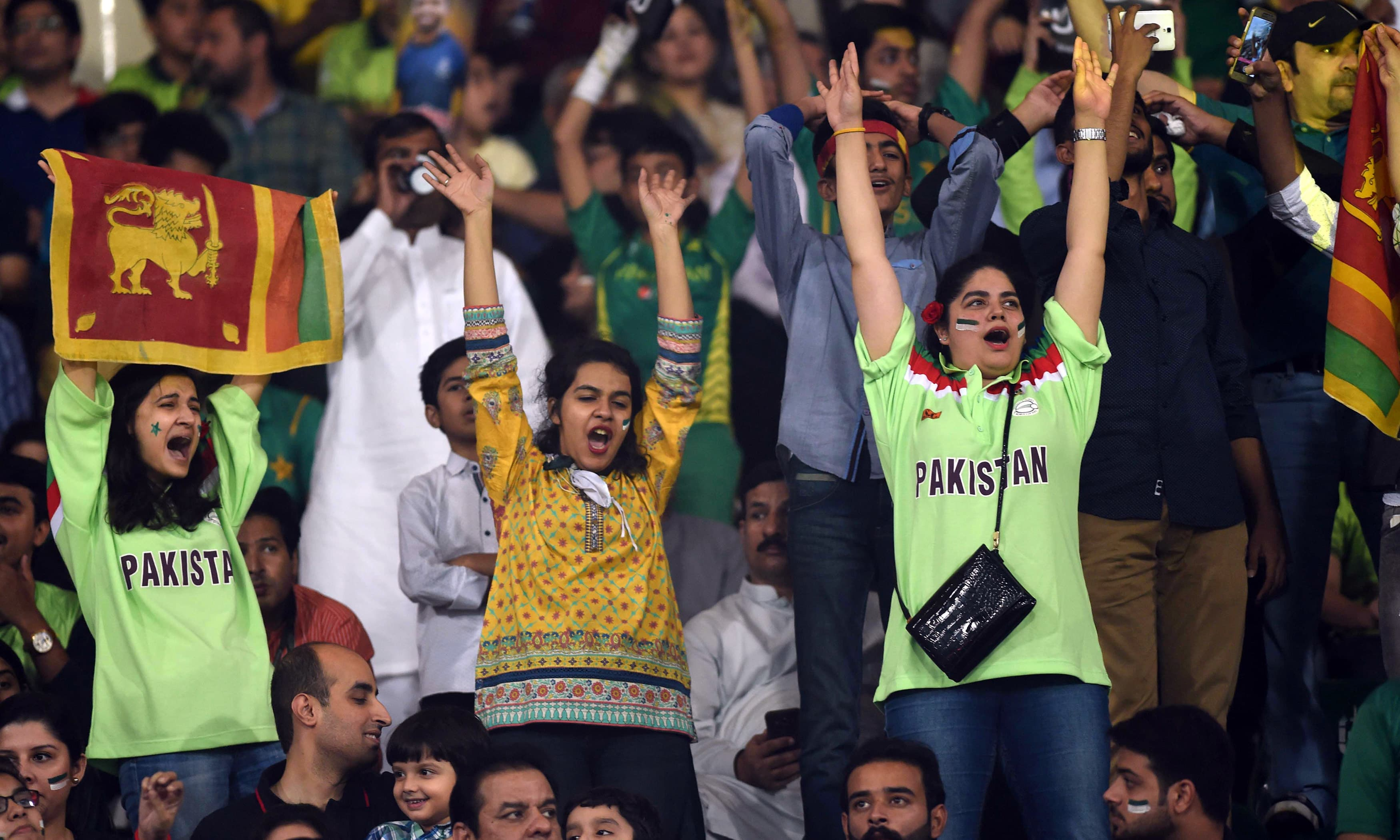 Spectators cheer during the T20 cricket match between Pakistan and Sri Lanka. —AFP