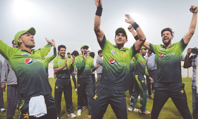 Pakistani players celebrate after winning the match.—AFP