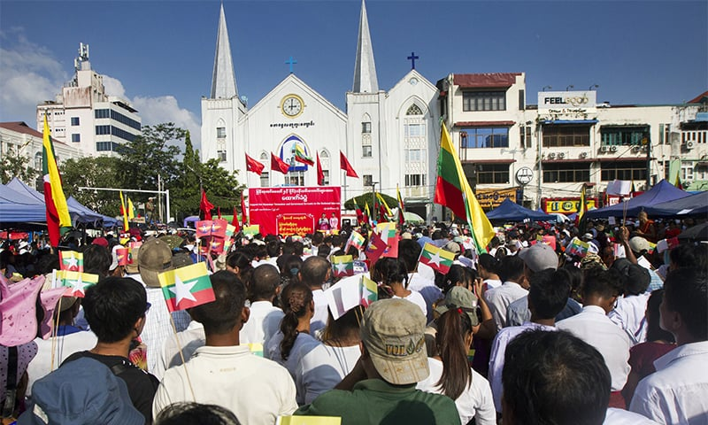 Participants attend a ceremony supporting the country's military and govt servant in Yangon.— AP
