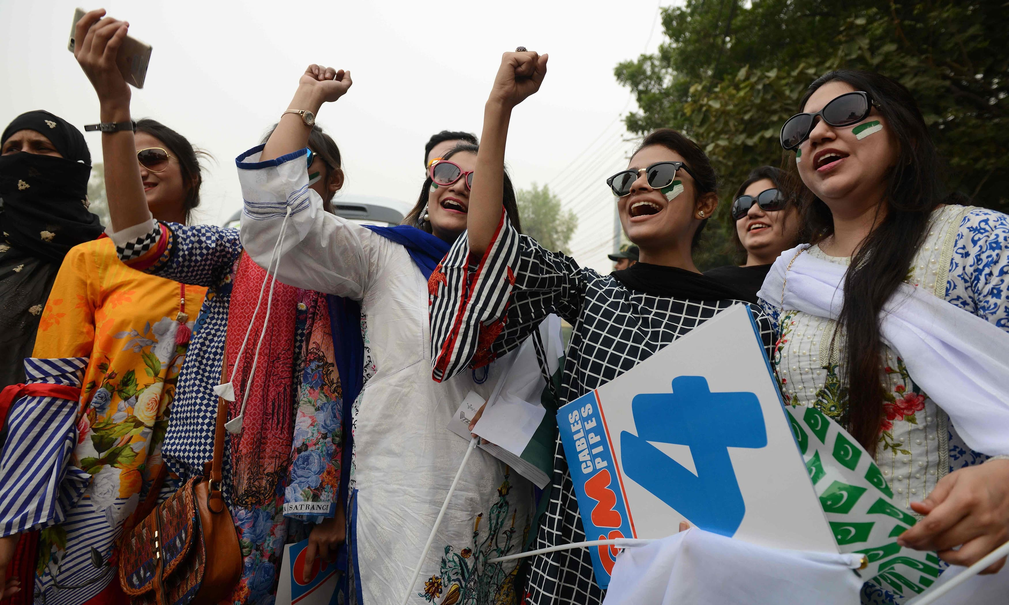 Women cheer as they arrive to watch the T20 cricket match between Pakistan and Sri Lanka. —AFP