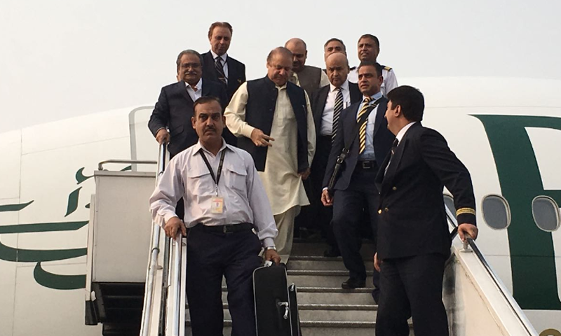 Nawaz Sharif disembarks from a PIA plane at Islamabad airport.— DawnNews