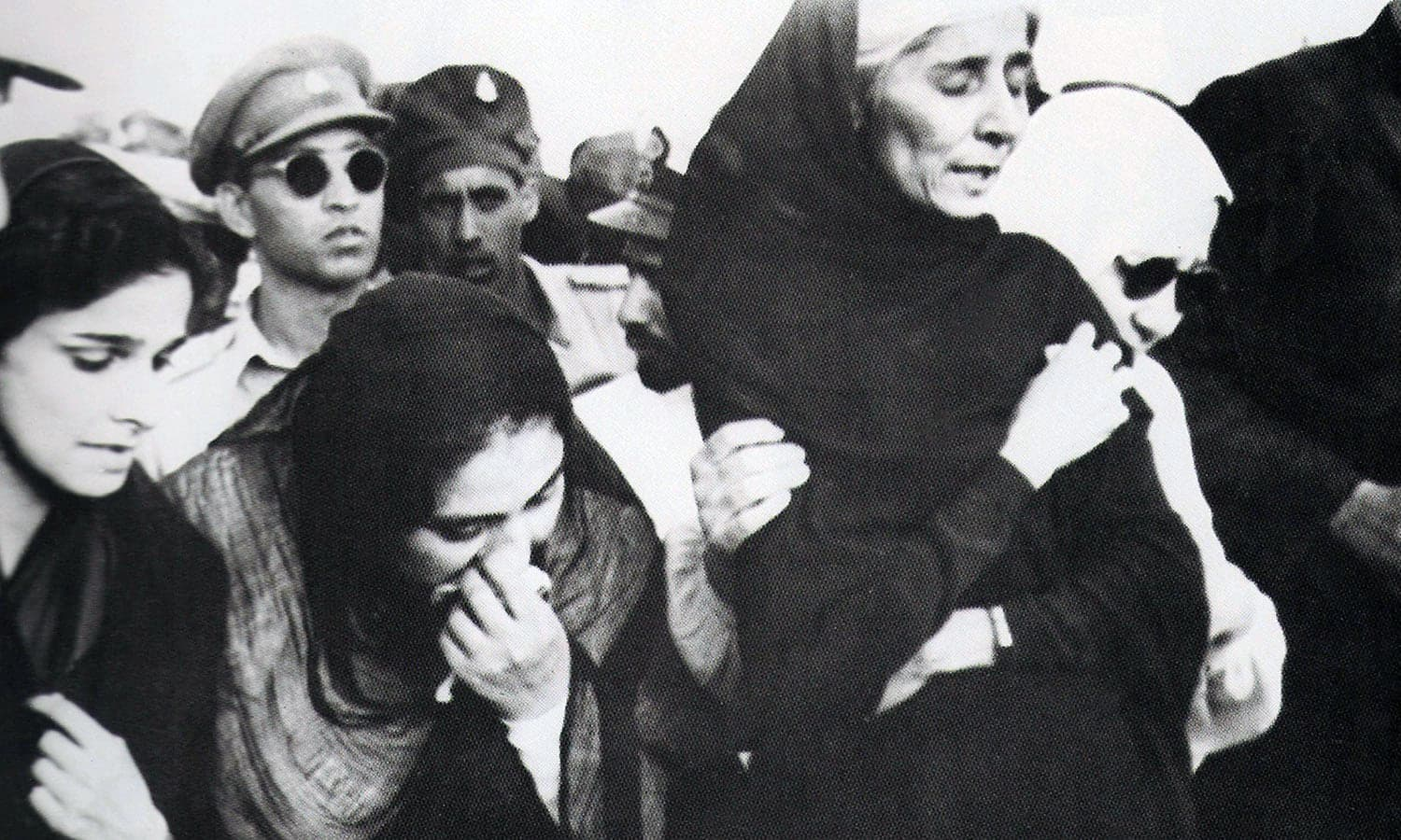 Dina Wadia (extreme left), Quaid-i-Azam Mohammad Ali Jinnah's only child, flew in from Delhi to attend her father's funeral. —Photo: The Press Information Department, Ministry of Information, Broadcasting & National Heritage, Islamabad