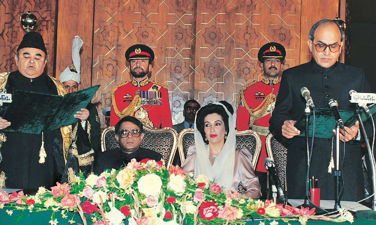 The day – November 13, 1993 – when Sardar Farooq Ahmed Khan Leghari (extreme right) took oath of the office of the country's president from Chief Justice Nasim Hassan Shah (extreme left) would have been a day of relief for Prime Minister Benazir Bhutto, seen here sitting alongside acting president Wasim Sajjad, for Leghari was her own nominee and that was critical in the presence of Article 58-2(B). A week short of three years later, the president dismissed her government using the same constitutional clause. The famed Shakespearean utterance, 'Et Tu, Brute?' must have crossed Benazir's mind at the time. Photo: Dawn / White Star Archives