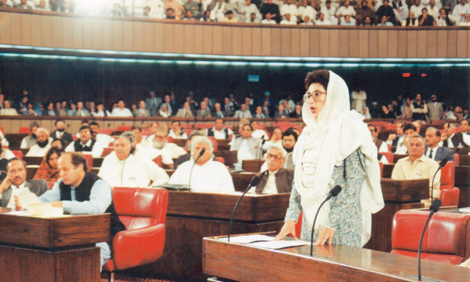 Benazir Bhutto had an eloquent presence in the National Assembly reminiscent of her father, the Quaid-i-Awam. | Photo: DEMP