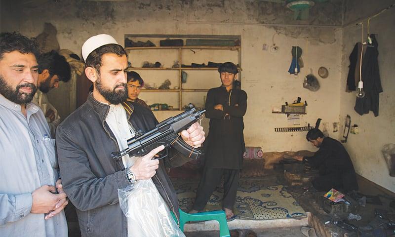 A manufacturer in Darra Adam Khel displays his newly made gun