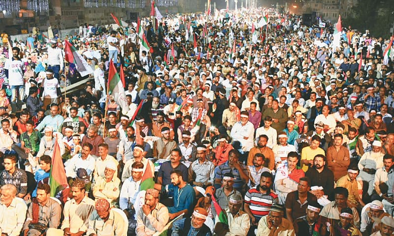 Participants in the MQM-P public meeting listen to their leaders' speeches on Sunday.—PPI