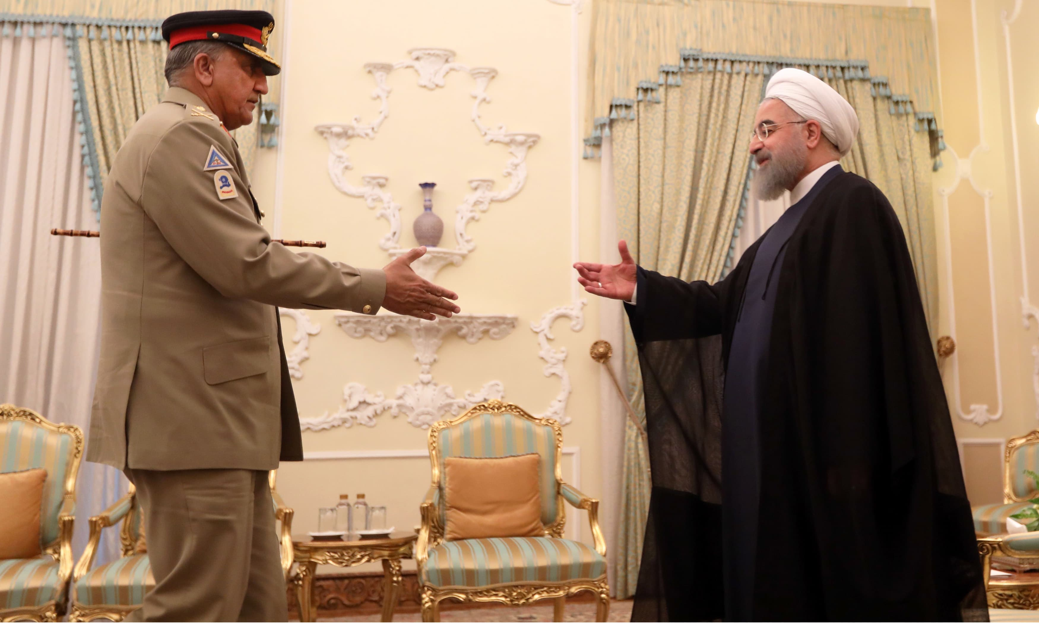 Iranian President Hassan Rouhani meets Army Chief General Qamar Javed Bajwa in Tehran. —AFP