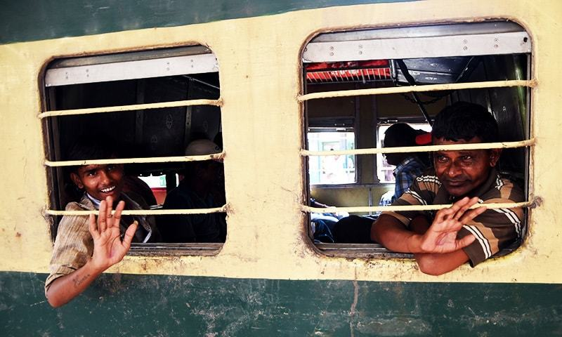 Indian fishermen released from Malir jail wave from train at a railway station in Karachi on October 29, 2017. -AFP