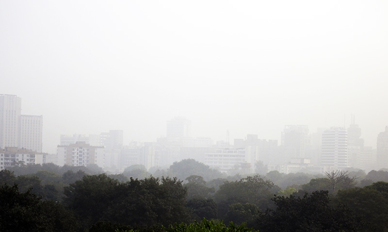 Smog envelops the skyline at noon in New Delhi, India.—AP