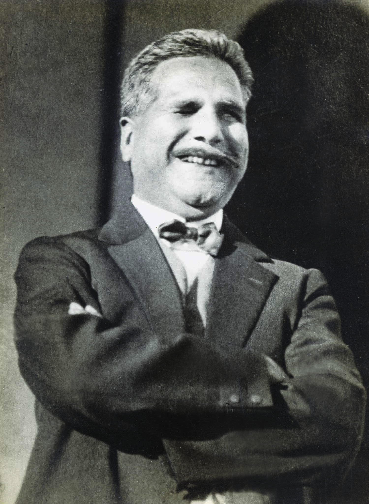 ELEGANTLY dressed in a suit, Allama Iqbal is seen having a lighter moment. | Photo: The Allama Iqbal Collection