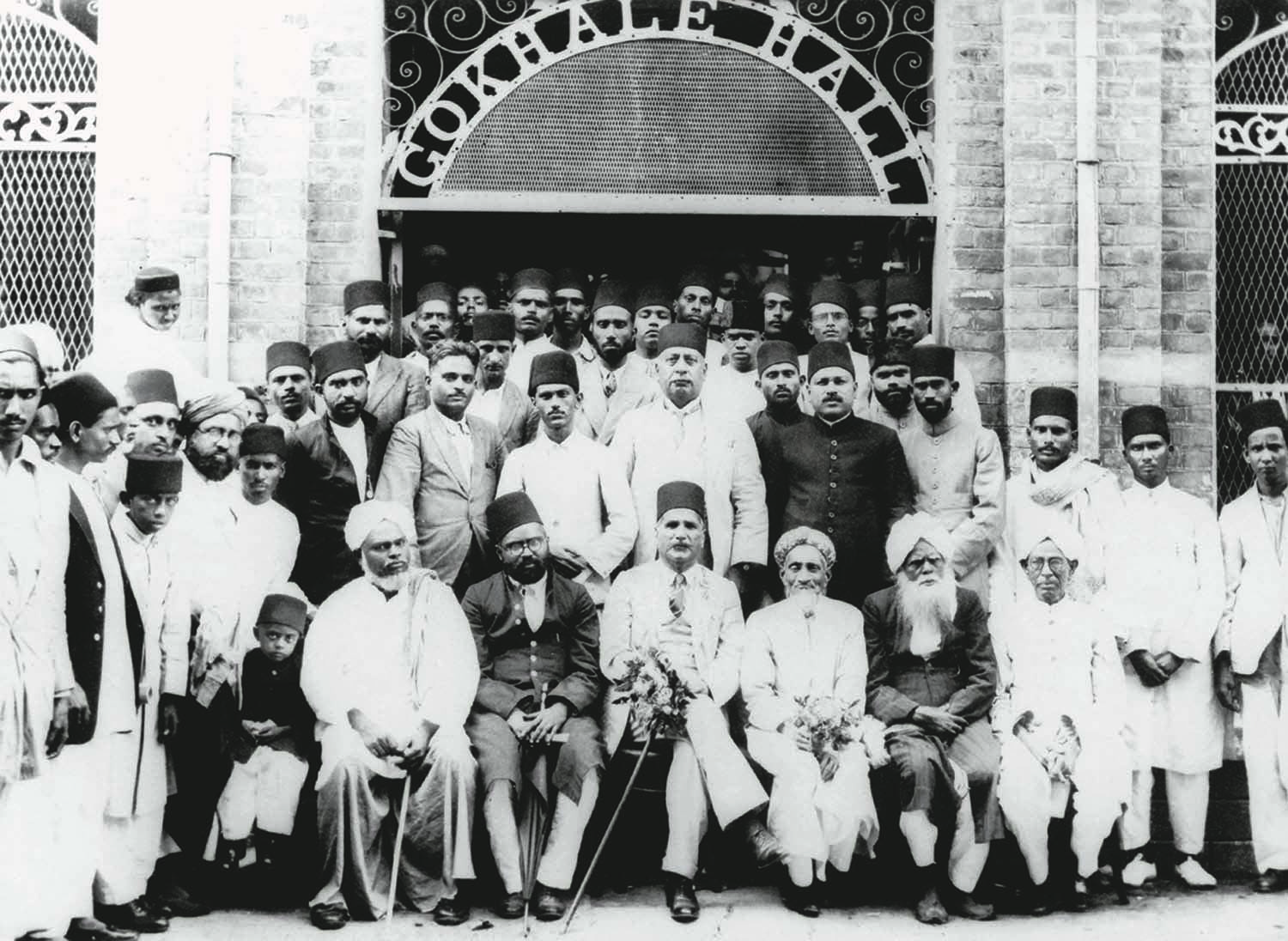 Allama Muhammad Iqbal (front row; centre) at the Gokhale Hall in Madras (since renamed Chennai) in 1929 after he had delivered one of his several famous lectures. The hall was named after Gopal Krishna Gokhale, a close friend of Quaid-i-Azam Mohammad Ali Jinnah, and a senior member of the Indian National Congress. | Photo: The Allama Iqbal Collection.