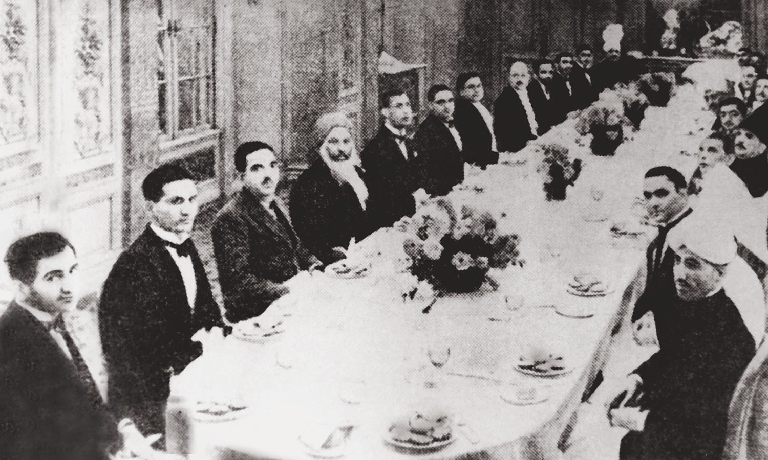 Allama Iqbal (centre; right in his characteristic headgear) sitting alongside Quaid-i-Azam Mohammad Ali Jinnah at the Round Table Conference in London (above).   Photo: The Allama Iqbal Collection