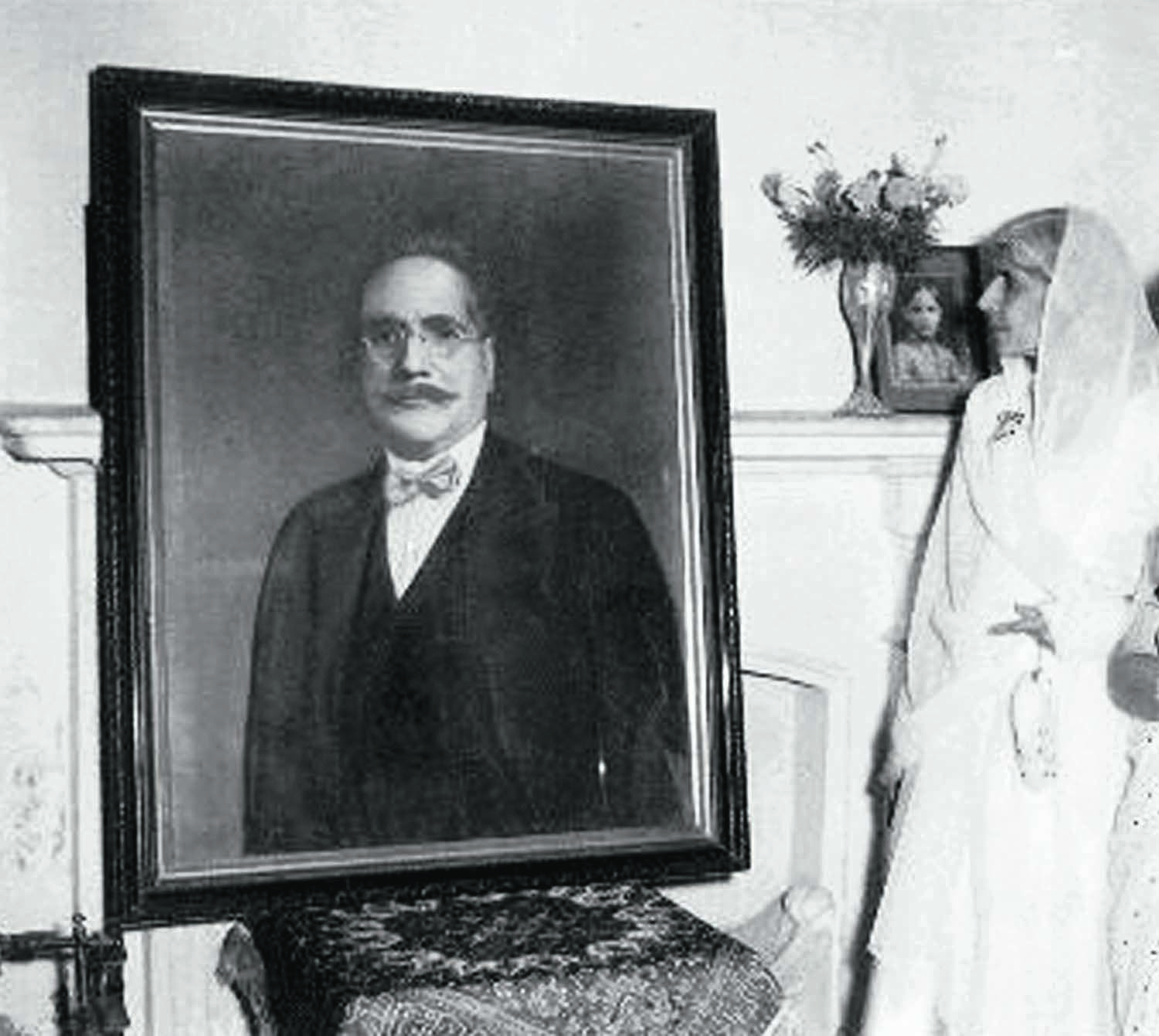 MISS Fatima Jinnah looks at a portrait of Allama Iqbal during a visit to his home in Lahore in the 1960s.   Photos: The Allama Iqbal Collection.