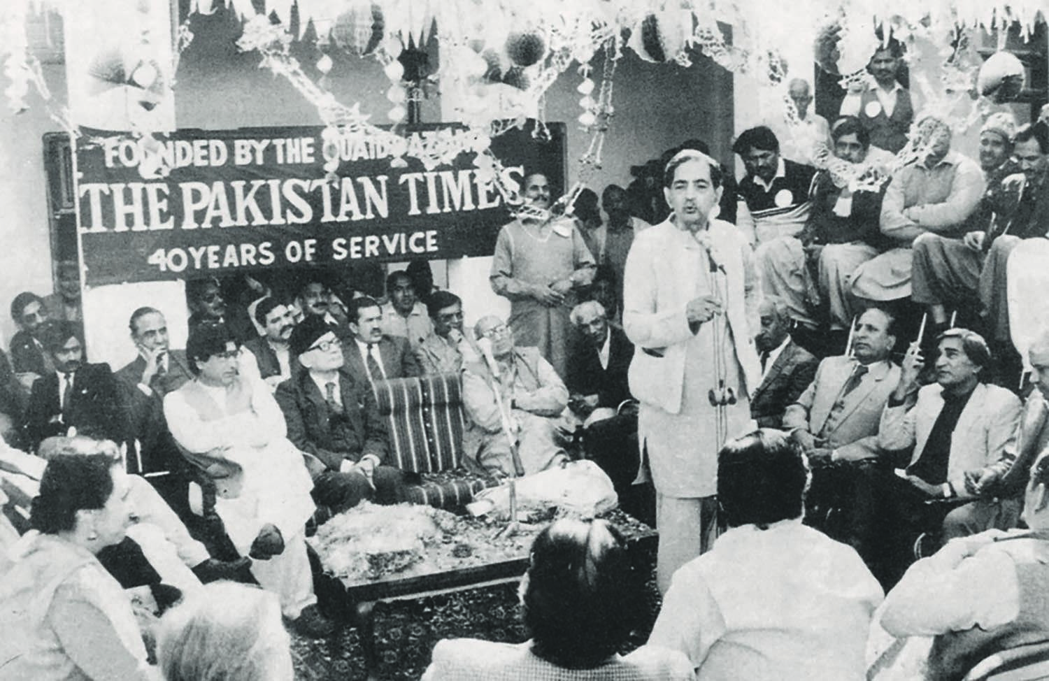Mazhar Ali Khan addressing members of *Pakistan Times* staff at a reception (above) to mark four decades of his service.   Photo: Mazhar Ali Khan Family Archives