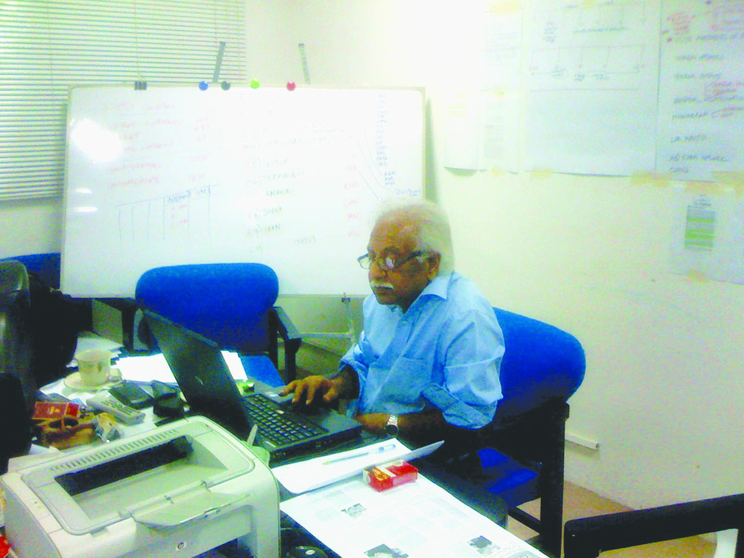SENIOR Journalist Idrees Bakhtiar seen at work in the 'special' newsroom that was set up at Dawn to select and redact Wikileaks material for publication.