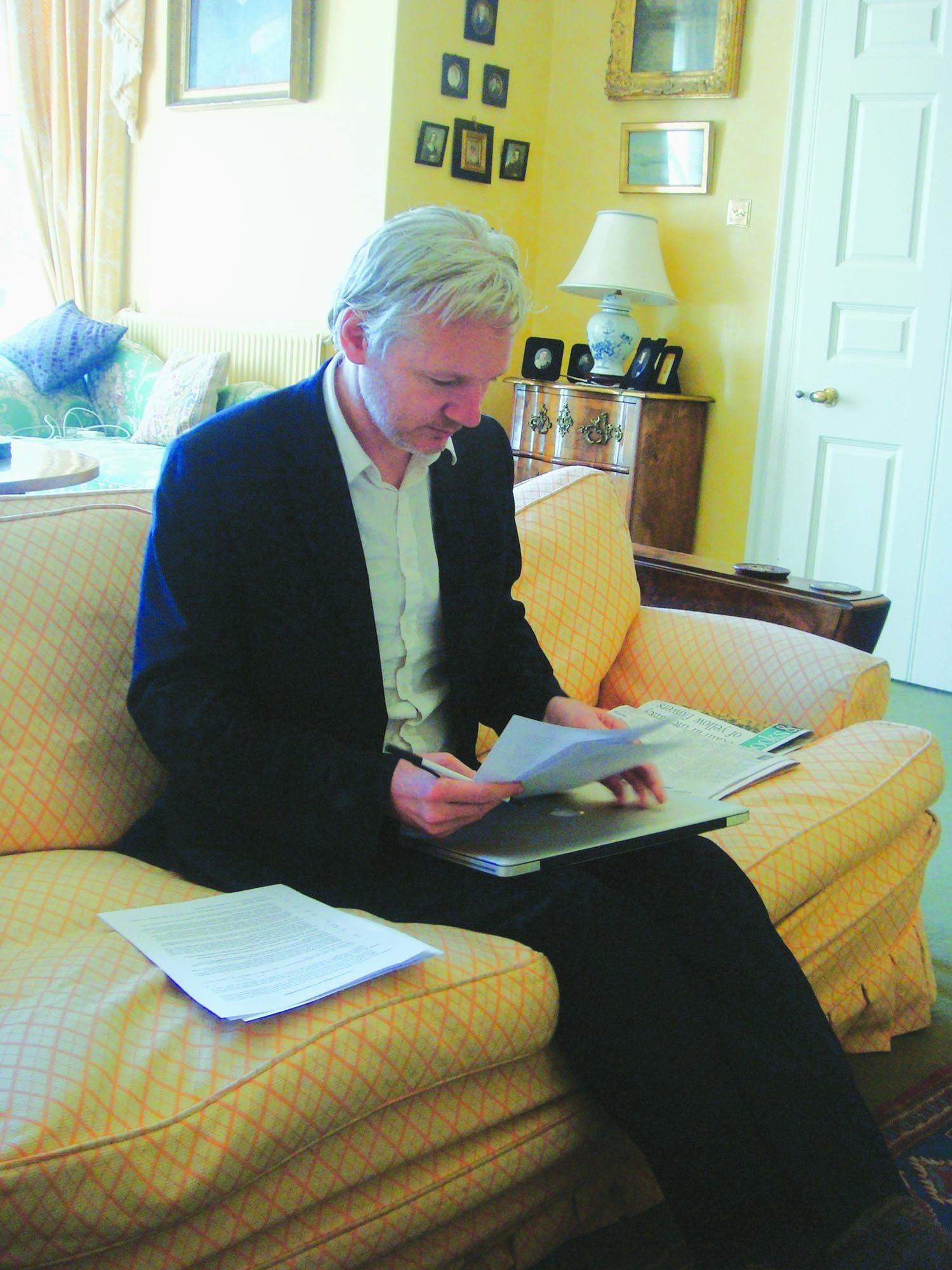 Julian Assange of the Wikileaks at his refuge in a London suburb in 2011 reviewing the draft agreement that he subsequently signed with Dawn, allowing it exclusive right to carry the content in Pakistan.