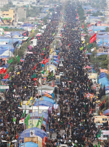 MAHMOUDIYA: Pilgrims march to Karbala for Arbaeen on Wednesday.—AP