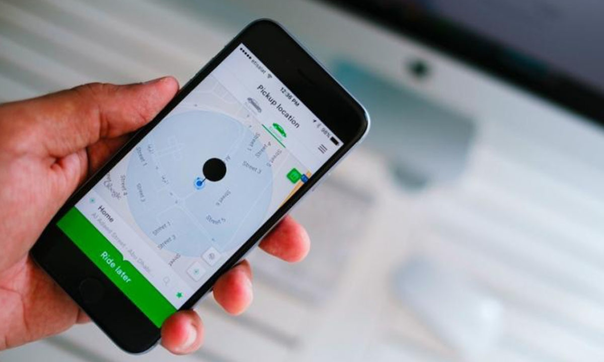 Careem's cellphone application through which customers book and manage rides | AFP