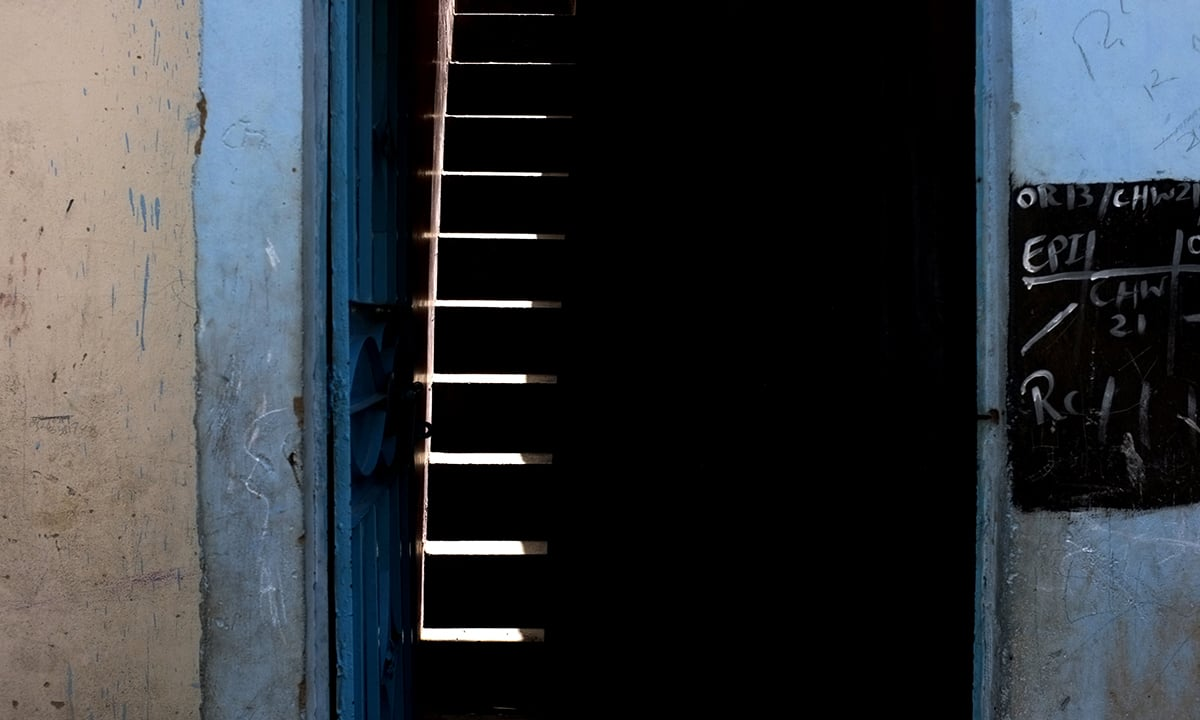 A doorway leading to a flight of stairs into a house in Baloch Goth, Karachi | Malika Abbas, White Star