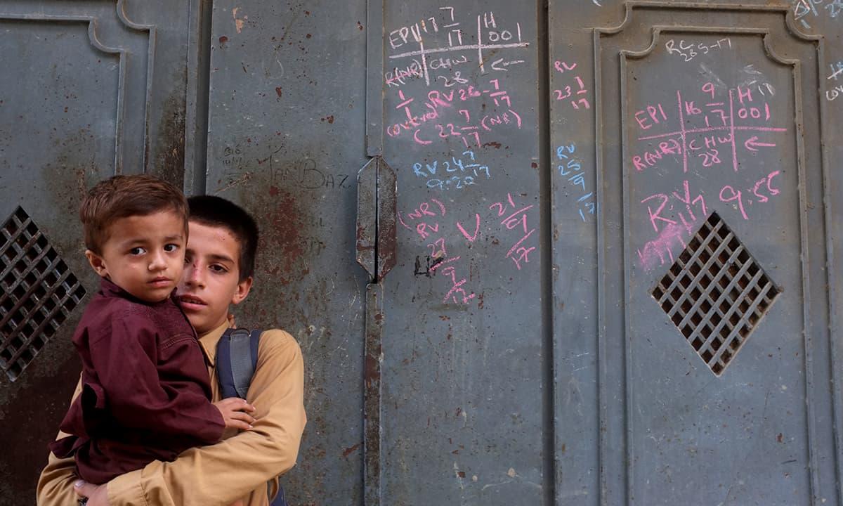 Two young residents of Khawaja Ajmer Nagri in New Karachi   Malika Abbas, White Star