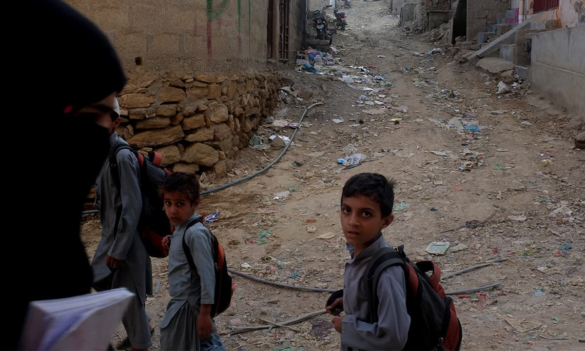 School-going children in Khawaja Ajmer Nagri, Karachi   Malika Abbas, White Star