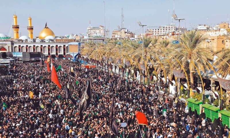 Pilgrims gather in front of Imam Hussein's shrine for Arbaeen which marks the 40th day after Ashura.—AFP