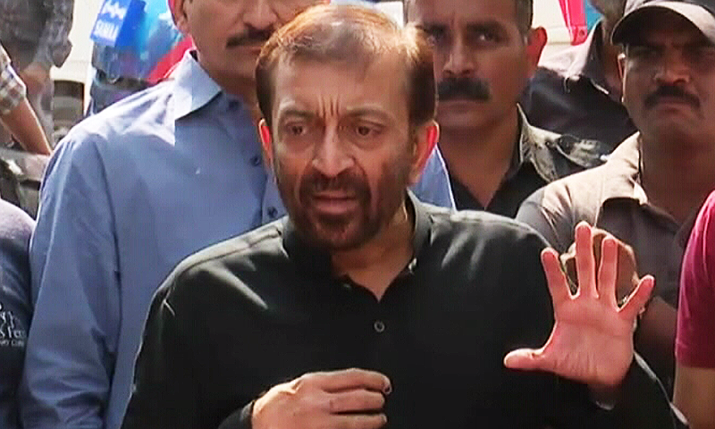 Farooq Sattar address press conference outside his residence. ─ DawnNews