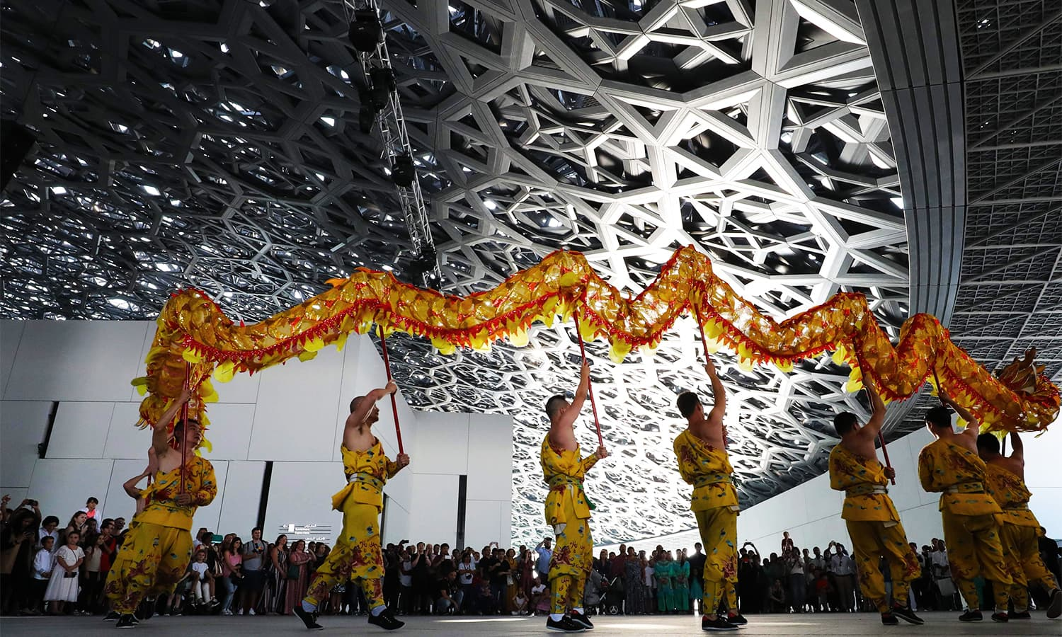 "Dancers from Korean musical ensemble ""Baraji"" perform during the opening of the Louvre Abu Dhabi Museum. — AFP"