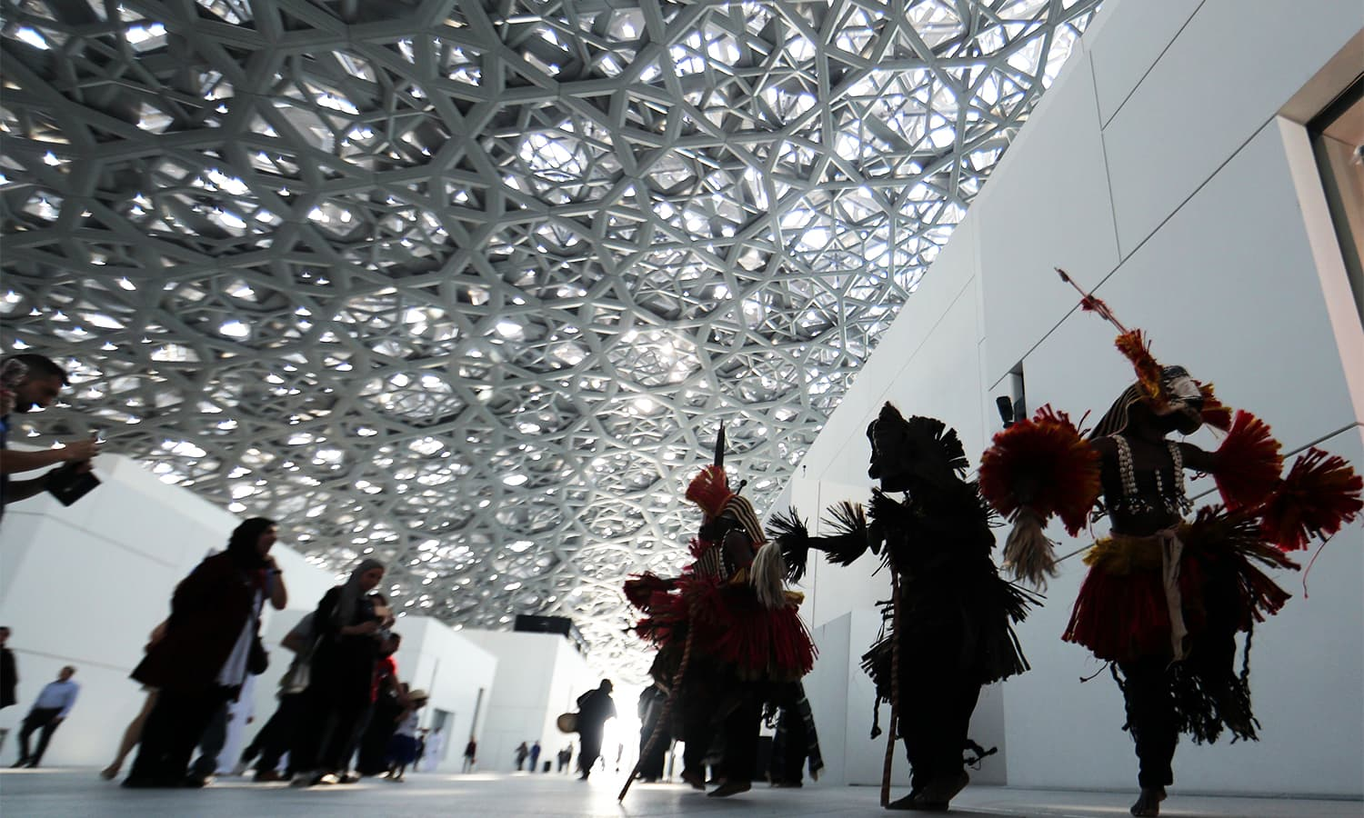 Dancers from the Malian Troupe Awa de Sangha perform during the opening of the Louvre Abu Dhabi Museum. — AFP
