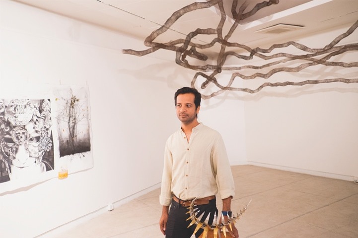 Ali Kazim with his untitled installation | Photo by the writer