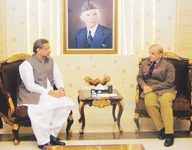 LAHORE: Prime Minister Shahid Khaqan Abbasi in a meeting with Punjab Chief Minister Shahbaz Sharif on Sunday.—Online