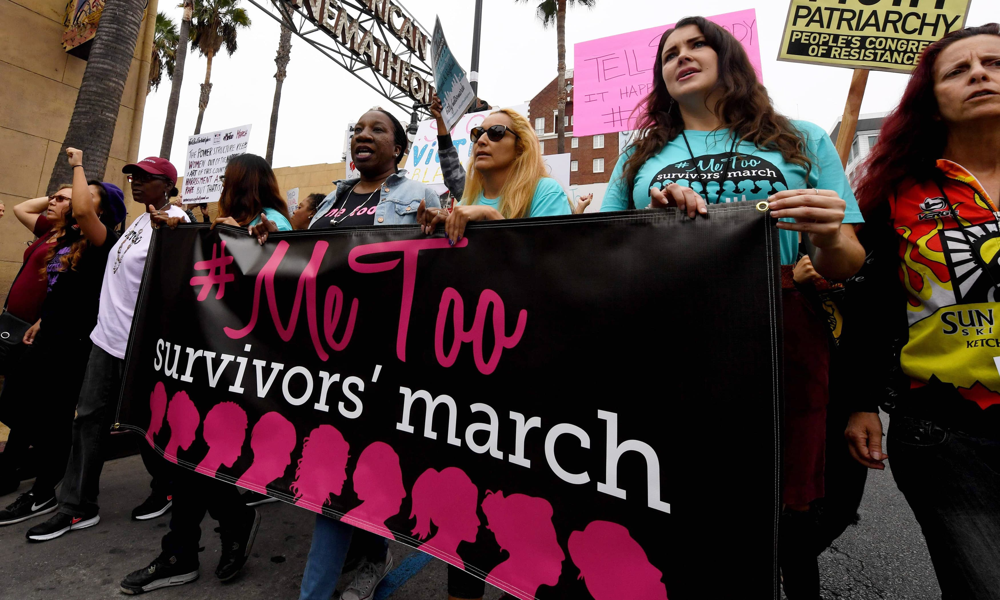 Victims of sexual harassment, sexual assault, sexual abuse and their supporters protest during a #MeToo march in Hollywood, California on November 12, 2017. —AFP